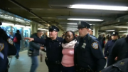 Woman arrested in NYC subway death